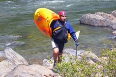 "How Do I Carry My Kayak?: A man carries a kayak using the ""Boat Over Shoulder Variation"" method."