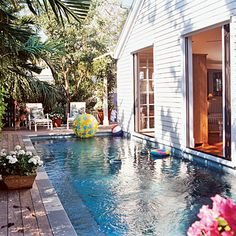 "Poolside Cottage: One of the best features of this cottage is the pool, which shares a wall with the home's foundation. ""The pool's location was bred out of necessity,"" the homeowner says. With two statuesque Spanish lime trees (a protected species) in the backyard, fitting a pool in was a bit of a challenge. But with the pool directly beside the house it becomes an extension of the living space."