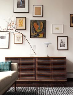 The Line Credenza, a modern storage piece for the living room, has four louvered doors and eight cubbies. The louvered design also serves a functional purpose, allowing infrared light to reach remote-controlled devices stored inside. Mid-century Modern, Modern Design, Modern Lamps, Modern Table, Modern Lighting, Lighting Design, Muebles Living, Design Within Reach, Clever Design