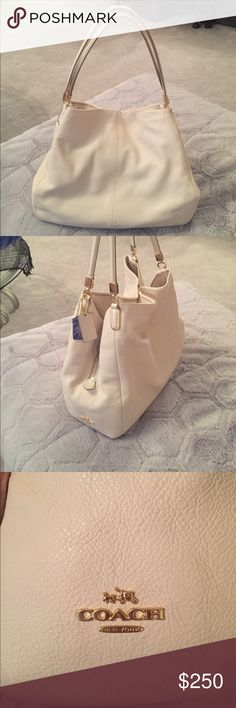 Coach Madison Purse Coach Madison cream leather purse. PRISTINE condition. Only worn twice. This purse has no marks in the lining or on the outside. It's such a beautiful bag...lots of compartments also....I am more than willing to take additional pictures if desired, just ask! I am asking $225 because of how new it is. Dust bag included. Reasonable offers welcome!! Coach Bags Shoulder Bags
