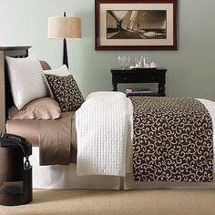 American Century Home™ Eliza Bedding Coordinates.  So sophisticated. I love whites & browns.  Bright white, waffle, quilted plaid pattern, nice crisp, classic look.  The throw is a brown and blue scrolled pattern.  I love KOHLS.  I registered for this in my wedding registry...