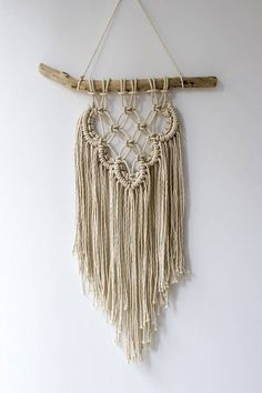 A beautiful bohemian inspired handmade macrame wall hanging. Use this decorative wall hanging to add a handmade touch to your home, office or cabin. Product details: 100% cotton 3 strand twisted cotton rope on handpicked driftwood Width of the hanger is aproximately 40cm. Length of the wall hanger is aproximately 63cm.