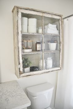 DIY antique window cabinet- See how to make this super easy vintage window bathroom storage. #repurposed #bath #diy