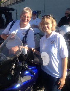 5T Executive Director Sonia Patterson with Peter Laser, who is riding his motorcycle from DC to Alaska to raise money for Five Talents.