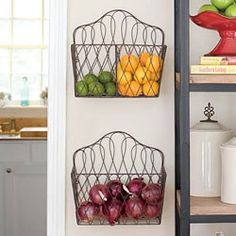 Hang magazine racks as holders for fruit and veggies. Love this idea!