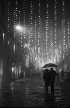 by Richard Bram.  The magic of walking through the city at night in the rain. I remember as a child how streetlights and traffic lights seemed to sparkle more,  reflecting in the drops and the puddles, turning a dark wet night into magic.