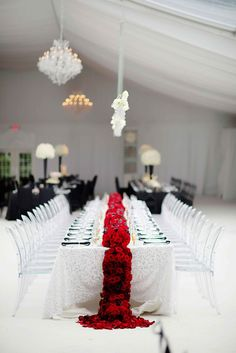 Red Floral Runner & Ghost Chairs at Modern Wedding | Photography: Kortnee Kate. Read More: http://www.insideweddings.com/weddings/black-and-white-modern-wedding-with-unique-details-in-cincinnati/698/