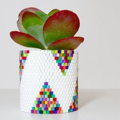 Learn how to make this fun and colorful woven bead planter with a step by step tutorial!
