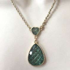 NWT 1928 Jeweled Pendant Necklace Stunning gold tone pendant necklace on a rope style necklace. Color is a soft green. 1928 Jewelry Necklaces