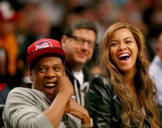 Laughing in love. Jay Z and Beyoncé have some fun while sitting courtside at the Brooklyn Nets versus Toronto Raptors NBA playoff game on May 2 in Brooklyn, N.Y.