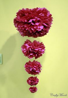Cascading poms. I think this could be made cute. With like strung pearls swooping around in places. Could put on on either side of a larger chandelier/whatever at the food area or something.