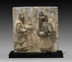 TWO SONG DYNASTY FIGURAL POTTERY TILES