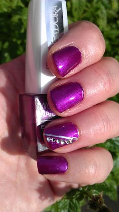 IsaDora Persian Princess - I'm in love with this! It's a perfect dark glittery fuchsia purple color, looks fabulous with everything I own. :)