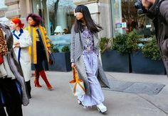 Susie Lau in a Rodebjer coat, Mary Katrantzou shirt, and Marques ' Almeida x Topshop pants