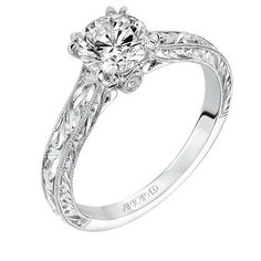 Vintage inspired solitaire diamond engagement ring with hand engraved milgrain detail and surpise diamond under center stone. Style: Philomena  #ArtCarvedBridal #ArtCarvedPinterest