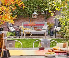 Makeover your patio this spring or summer on a budget! We show you a real life paver patio that includes some thrifty DIY projects to complete this patio makeover on the cheap. Upcycled patio furniture, a DIY paver patio and a few colorful decor items make this patio look amazing.