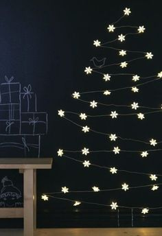 Tree made with Christmas lights by Ikea | holiday trends 2013 - black & white