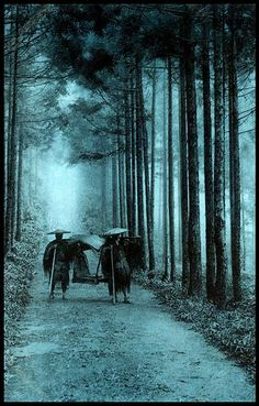 Two coolies carry a ghost through the fog and trees...1920s, Japan