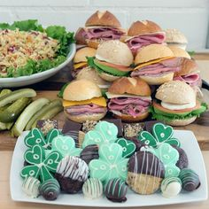 Ingllina's Box Lunch Seattle offering Monthly and St Patricks Day Special Combo Platters; it Comes with a St. Patrick's Day Sandwich Tray, Potato Salad and Shamrock Goodie Tray.