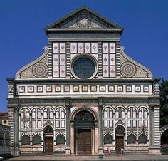 The facade of Santa Maria Novella in Florence, by Alberti. Though it's not rain screen by definition, but convey the similar idea of departing the external facade away from the internal structure.