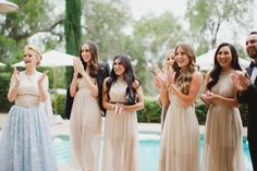 Morgan Stewart's bridesmaid in neutral shades: http://www.stylemepretty.com/2016/06/20/steal-the-look-morgan-stewarts-glam-all-white-wedding/