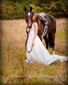 Bride with Horse may not be a stunt, but I want this to be a part of my future wedding! My horse is just as important as my friend. Actually my horses are some of my best friends! How could I live without them being at my wedding!