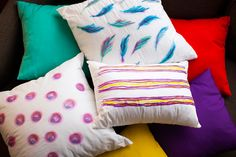 Use sharpies and rubbing alcohol to DIY these watercolor-inspired throw pillows.