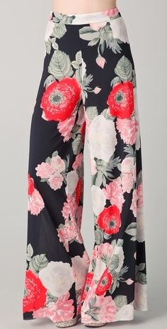 These high-waisted, wide-leg Alice + Olivia pants feature a floral print and an exposed back zip.