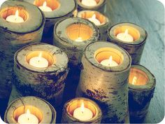 by Candi Mandi on flickr. Made with birch, drilled holeds and used flameless candles or votives.
