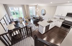This is the Spartan townhome model home in Findlay Creek. New Home Builders, Model Homes, Townhouse, New Homes, Dining Table, Building, Kitchen, Furniture, Home Decor