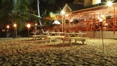 Zaccios Restaurant is located on one of the lovely beaches on the west coast of Barbados, in the heart of Holetown. Most Favorite, Barbados, Restaurant Bar, Places Ive Been, Patio, Table Decorations, West Coast, Outdoor Decor, Holiday
