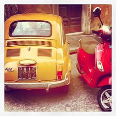 That moped is bigger than that Fiat 500!
