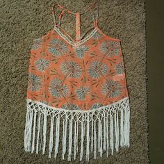 Miss Me Tank Orange tank top with white tassle like fringe, paid $53 for it, took the tags of and never wore it. Super cute detailing on the straps front & back! Floral design, kinda like daisys or dandelions. Perfect for summer, wearing it over a swimsuit to a lake, river or the ocean! Get it for your next vacation! Price negotiable Miss Me Tops Tank Tops