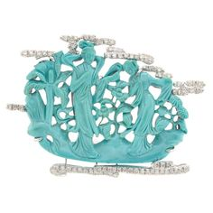 White Gold, Carved Turquoise and Diamond Brooch  14 kt., one carved turquoise ap. 41.5 x 56.5 mm., single-cut diamonds, ap. 16 dwts. gross.