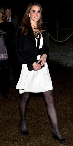 Kate Middleton WHAT SHE WORE Middleton paired a tiered silk Temperley London dress with a blazer and black heels to attend the Christmas Spectacular in London with Prince William by her side.