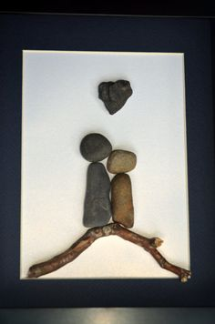 Not homemade, but would be pretty easy to recreate. Simple, but effective. Stone Couple on Driftwood with Heart Rock. 8 X 10 par SticksnStone, $50.00