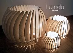 The conception of the Lamela started with the material it is made of: used MDF. This material, considered industrial waste, was used as a bottom layer for a cnc milling machine that cuts different types of sheet material. It has a structure on … Lampe Laser, Laser Cut Lamps, Diy Lampe, Cardboard Furniture, Wooden Lamp, Diy Holz, Unique Lamps, Laser Cutting, Lamp Light