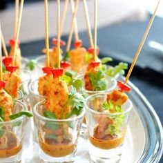 Easy Thai Chicken Satay (all dressed up for a party!), served here with peanut satay sauce and fresh coriander.  D.Schmidt for About.com Recipe Appetizers with boneless chicken skinless thigh, red bell pepper, marinade, lemongrass, ground coriander, ground cumin, tumeric, white pepper, fresh red chili, fish sauce, fresh coriander, garlic, galangal, white sugar, rice vinegar, liquid honey, vegetable oil