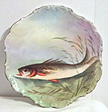Here is a wonderful hand painted fish plate signed Rene on a blank made by Flambeau China. It measures 10 inches in diameter and was made ca. 1890s-1914. Similar fish plates by this artist are picture
