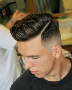 high fade hard part pompadour haircut