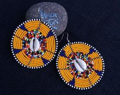 Maasai Beaded Statement Jewelry for the head-turners by AfricaZuri African Earrings, Tribal Earrings, Etsy Earrings, Tribal Jewelry, Handmade Items, Handmade Jewelry, Unusual Jewelry, Shell Jewelry, Will Turner