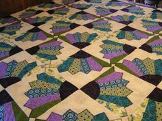 bow tie fan quilt.  Might be fun to make from old neck ties.