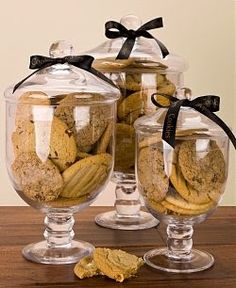 Cookie Jars...what a beautiful way to display cookies.  Red ribbons for the holidays~perfection!