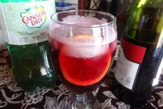 Portuguese Wine Cooler recipe -   Lots of Ice - 1 part Ginger Ale - 1 part Portuguese Red Wine - 1 Orange Slice! Yumeasy!
