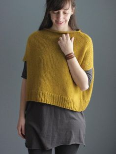 "Is it a caplet with armholes or a poncho? I think it's a little bit of both so I named it ""Capo""! This simple sleeveless top is a fun layering piece that is super cozy and really easy to make too.It's worked seamlessly in the round from the bottom up and uses bulky-weight yarn - I used Berroco Catena which is a perfect yarn because although it's bulky-weight it feels light as air when it's knit up."