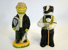 218) Acorn ceramic figure of a Badger playing snooker and a similar figure of a frog playing lacrosse Est. £10-£15