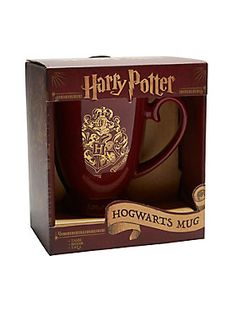 """<div>Enjoy your morning coffee like a witch or wizard. This red cup features gold foil detailing of the Hogwarts crest and filigree. It'll turn a regular morning into a magical one.</div><div><ul><li style=""""list-style-position: inside !important; list-style-type: disc !important"""">Ceramic</li><li style=""""list-style-position: inside !important; list-style-type: disc !important"""">Hand wash only; not dishwasher or microwave safe</li><li style=""""list-style-position: inside !important; list-sty..."""