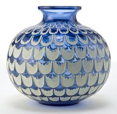 Art Glass:Lalique, R. LALIQUE BLUE GLASS GRENADE VASE WITH WHITE PATINA . Circa1930. Engraved: R. Lalique, France . 4-3/4 inch...