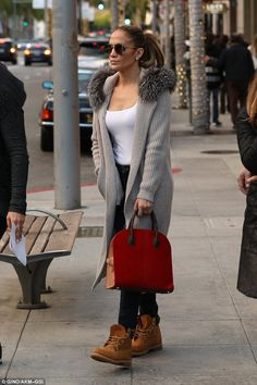 Smokin: J-Lo looked hot as always in a pair of skinny jeans and personalised gourd Timberland boots