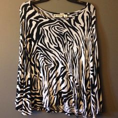 Versona Zebra Cape Cape style top with arm holes. It is showing some wear but not noticeable in pictures. The top is super soft and comfortable 95% rayon, 5% spandex. Size medium but runs a little small.  Front length: 19 inches  Back length: 22 1/2 inches  Sleeves 23 inches. Negotiable through offer button. Versona Tops Tunics